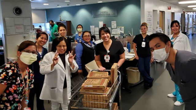 Grateful hospital staff with pizza