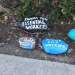 Painted rocks along a north La Mesa sidewalk salute and thank essential workers, including farmers and healthcare worksrs.