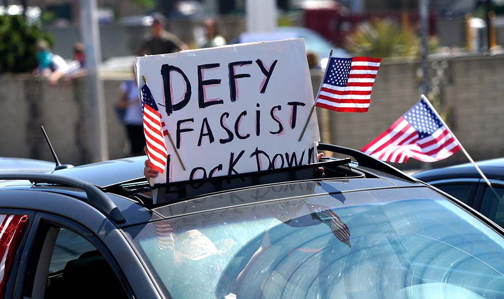 Protesters in cars showed support with their signs in Pacific Beach.