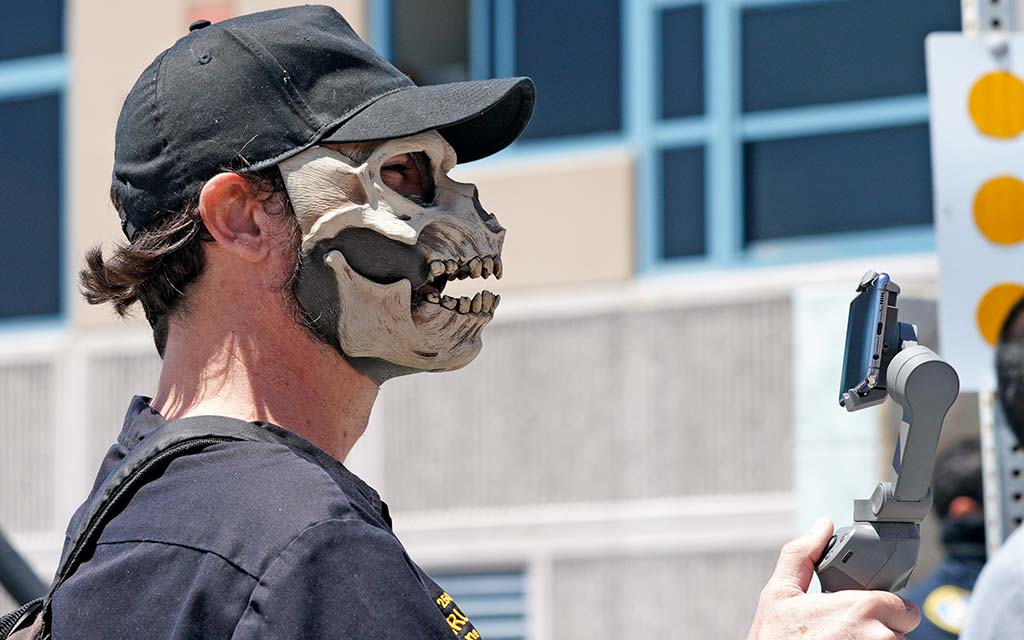 Protesters wore a variety of masks at the Pacific Beach protest.