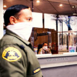 Sheriff's deputies were bandanas as face masks