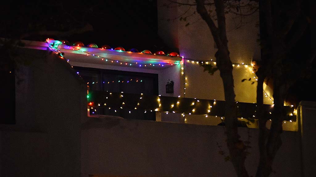 Christmas lights are added to a balcony on Kettner Boulevard in downtown San Diego.