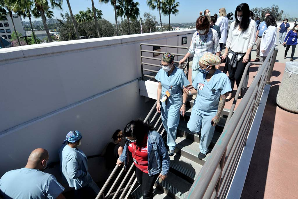 Sharp Grossmont Hospital staff heads down stairs after what they thought was end of aerial display. Another flight group followed.