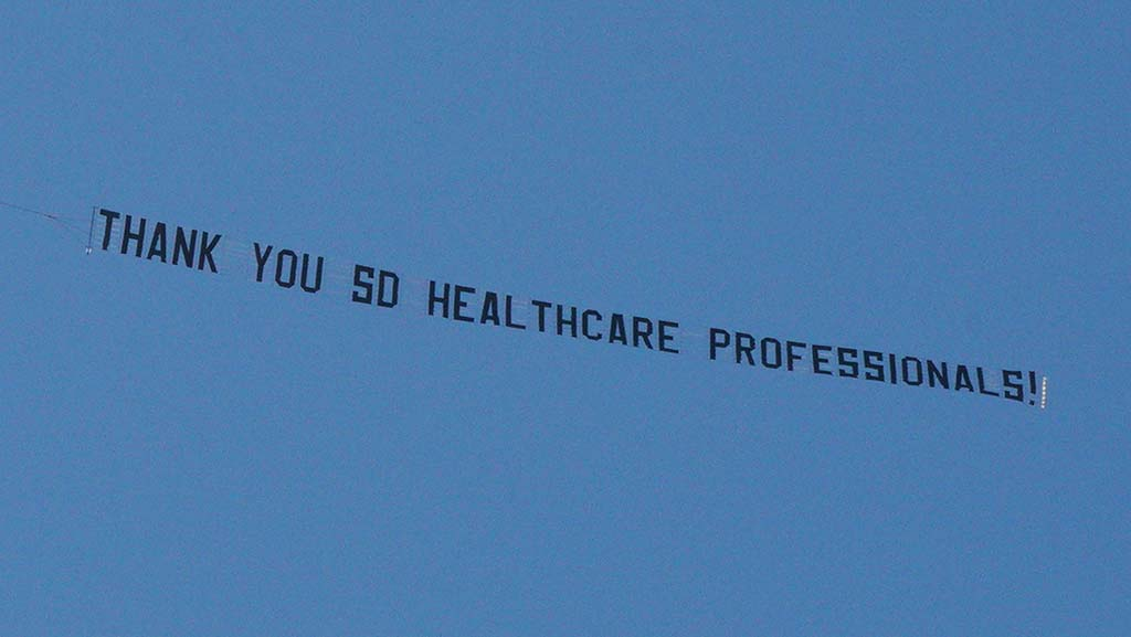 J.D. Money tows 75-foot banner past Sharp Grossmont Hospital as a thank-you to healthcare workers.