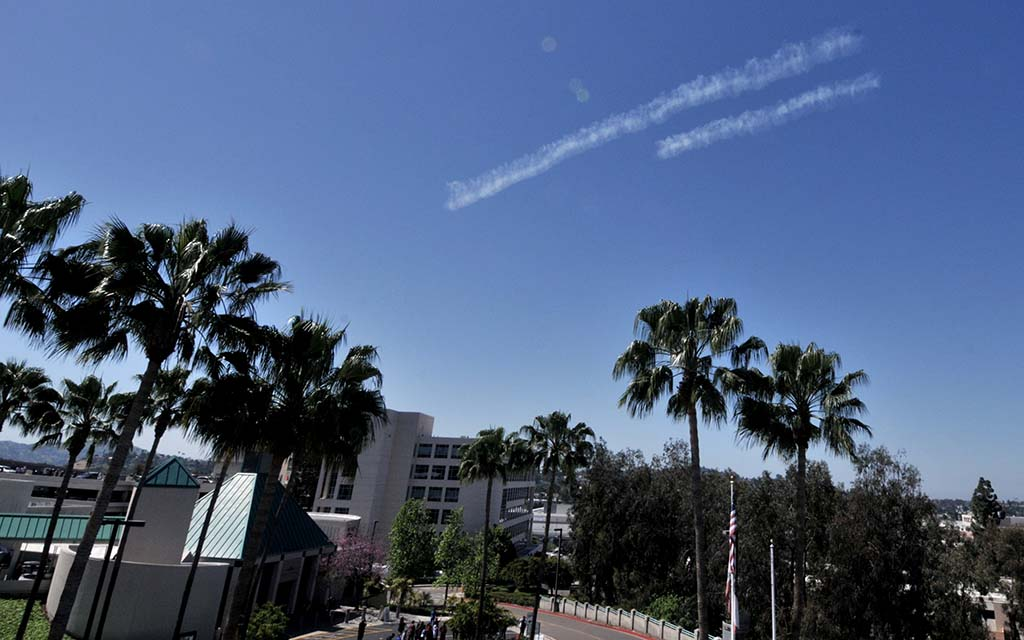 Smoke trails were left by two of four Steerman planes over Sharp Grossmont Hospital in La Mesa.