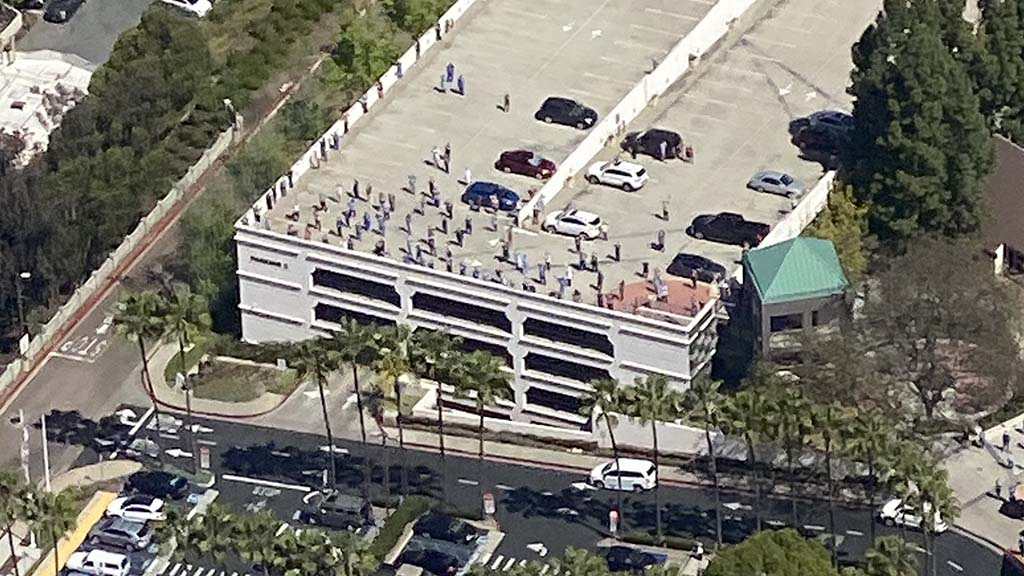 Pilot J.D. Money towed a banner 5-foot high by 75 feet long and had this view of Sharp Grossmont Hospital staff gathered on parking garage.