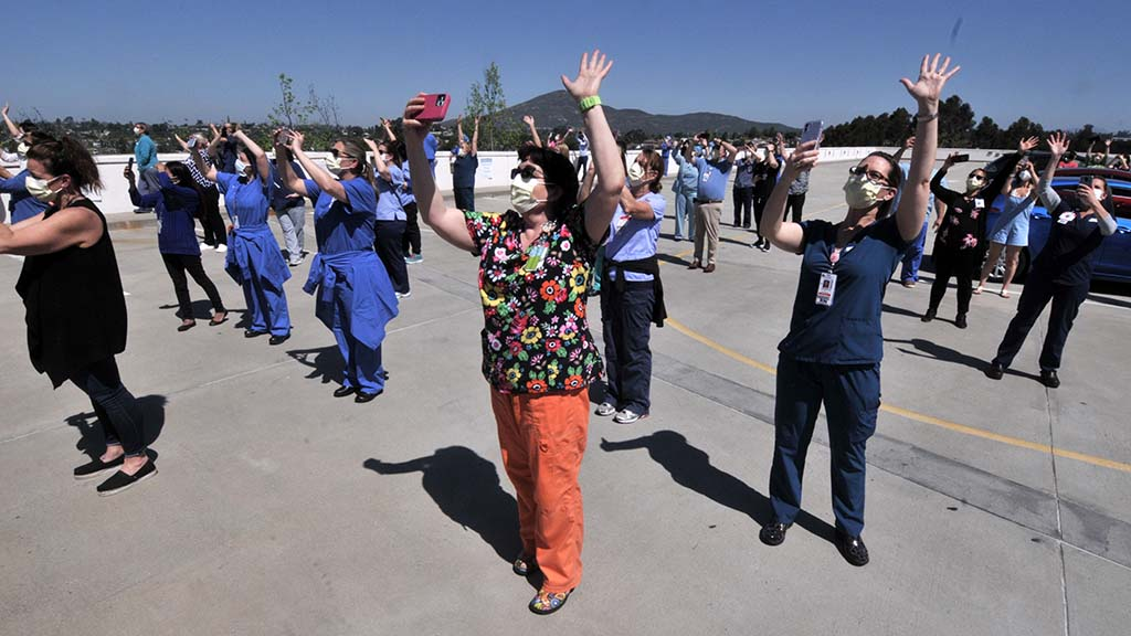 La Mesa hospital workers wave at planes taking part in fly-over of five San Diego County hospitals as thank-you to caregivers.
