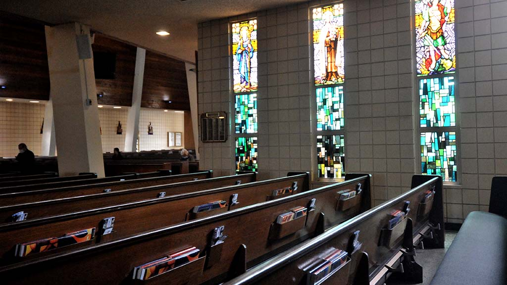 Several people prayed in a quiet St. Rose of Lima Church in Chula Vista on Palm Sunday.