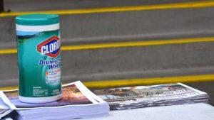 Disinfecting wipe and gloves were on hand as palms, bulletins and the Southern Cross diocese newspaper were given to parishioners in their cars.