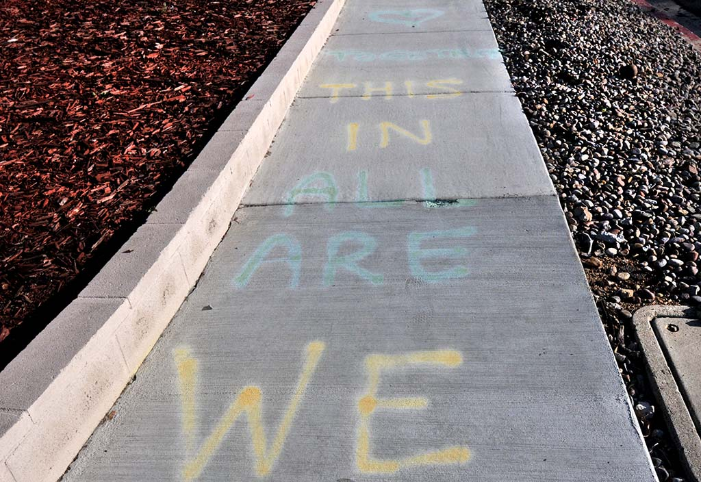 """We are in this together,"" Lindsay Mitchell wrote to her neighbors on the Crawford Street sidewalk."
