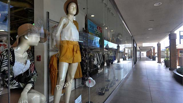 Mannequins at Papaya store appear to be overlooking the empty Mission Valley Mall.