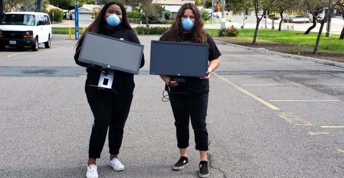 Ulyssa Easley (left) and her friend, Malinda Valdez, picked up donated computers during one of Southwestern College's distribution days.