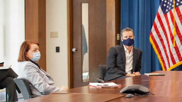 Toni Atkins and Gavin Newsom in face masks