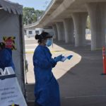 San Diego County healthcare workers conduct COVID-19 testing at SDCCU Stadium. Photo by Chris Stone