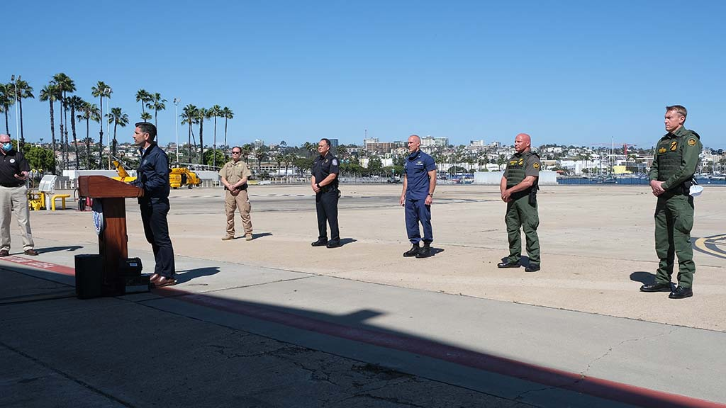 Members of Border Patrol, U.S. Coast Guard and the Department of Home Security appeared with Chad Wolf.