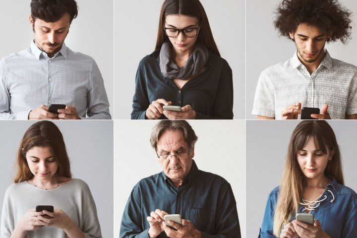 People using smartphones for contact tracing