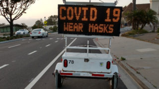 Sign warning residents to wear face coverings