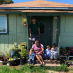 An immigrant family outside their home near Merced