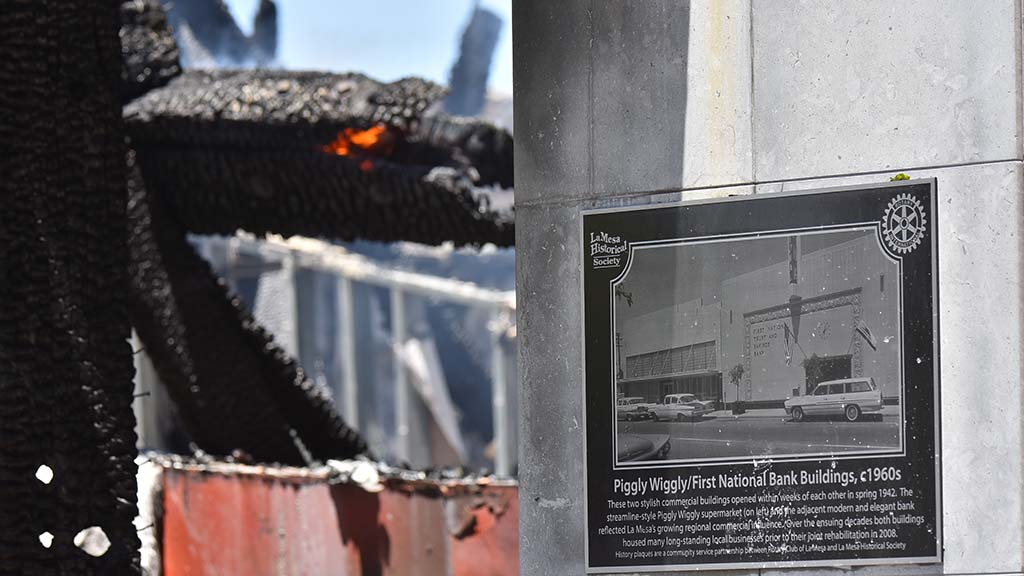 A La Mesa Historical Society plaque remains in front of the burned building that was being used by Randall Lamb a engineering consulting business.