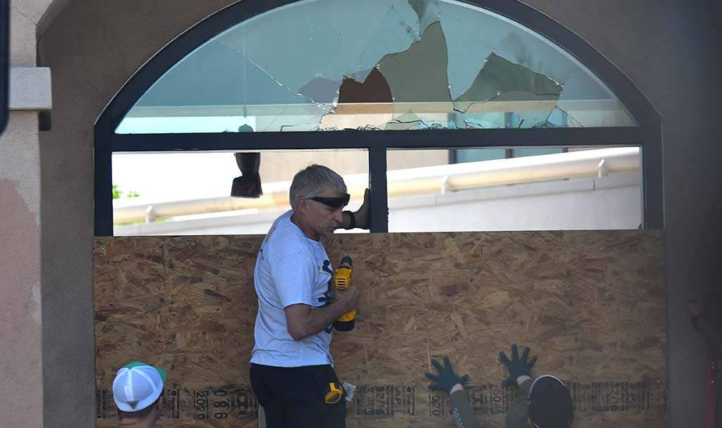 Volunteers gathered by the thousands in La Mesa Sunday morning to repair damage done by protestors the night before, such as this La Mesa Police Department window.