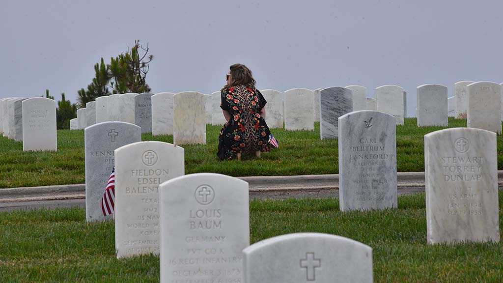 Family members stopped by Fort Rosecrans National Cemetery despite the cancellation of the public ceremony.