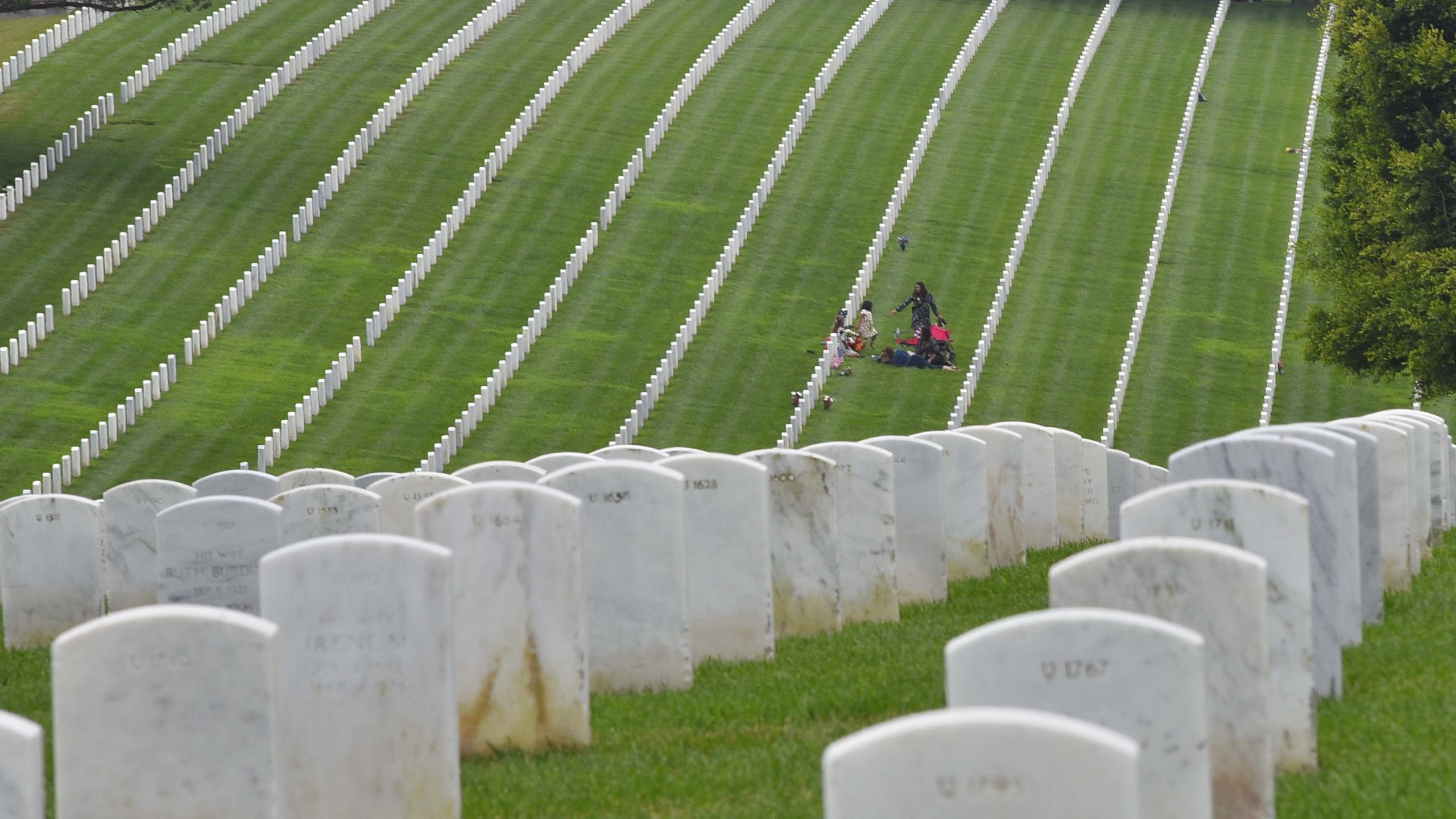 While people weren't invited to a public Memorial Day service at Ft. Rosecrans National Cemetery, families and friends streamed onto the grounds to pay their respects to their loved ones.