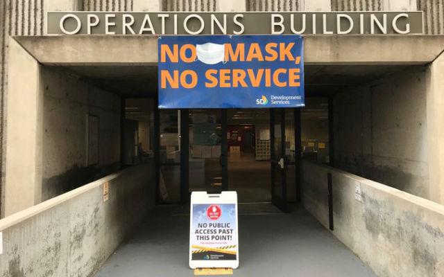 """No mask, no service"" sign"
