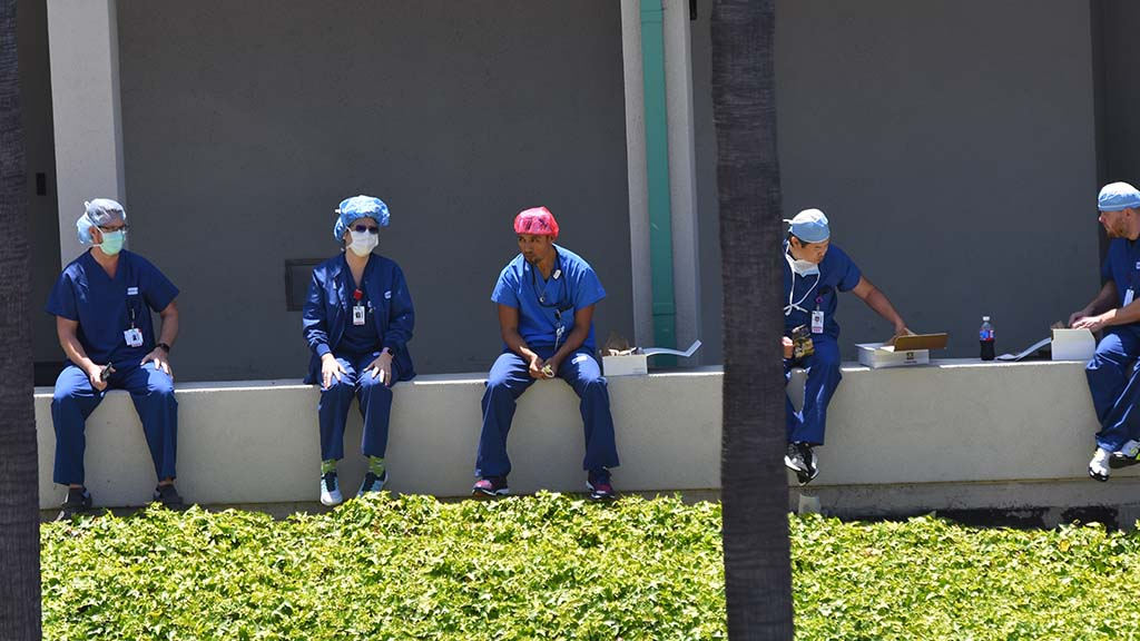 Sharp Grossmont Hospital workers wait arrival of U.S. Air Force Thunderbirds' flyover.