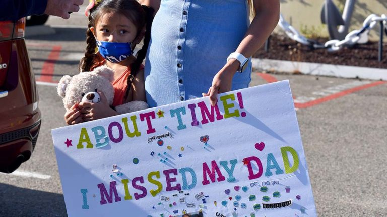Keala Cavatero, 5, waits for the return of her father on the USNS Mercy.