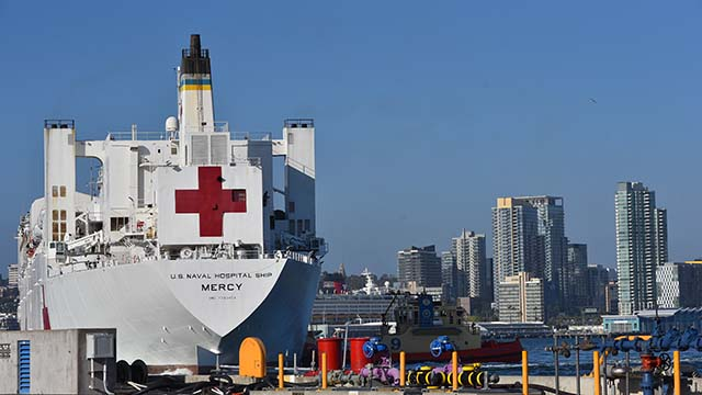The USNS Mercy returned to San Diego with about 350 crew members. Medical personnel were bused back starting Tuesday.