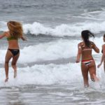 Three young ladies take a plunge into the 66-degree sea water at Ocean Beach on Memorial Day.