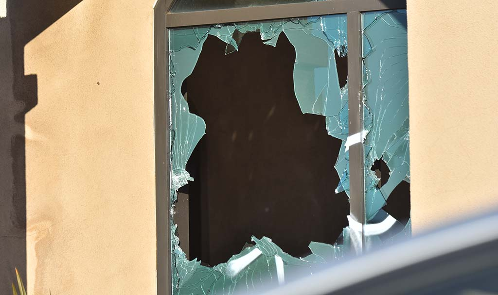 The La Mesa police station bears scar of a broken window near Baltimore Drive and University Avenue intersection.