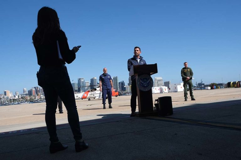 Acting Homeland Security Secretary Chad Wolf hears a question during visit with reporters at the U.S. Coast Guard Station near Lindbergh Field.