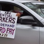 San Diego County workers joined a union caravan to demand sufficient protective equipment and hazard pay.