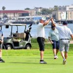 Golfers in foursome at the Coronado municipal course high-five after finishing play over the weekend — the first time they could play in weeks.