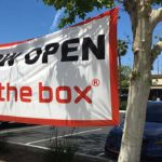 San Diego-based Jack in the Box Inc. is famed for 24-hour service at many outlets. But with the pandemic, the fast-food chain's store at Lake Murray Boulevard and Dallas Drive in La Mesa isn't taking chances, reminding drivers that the drive-through window is open.