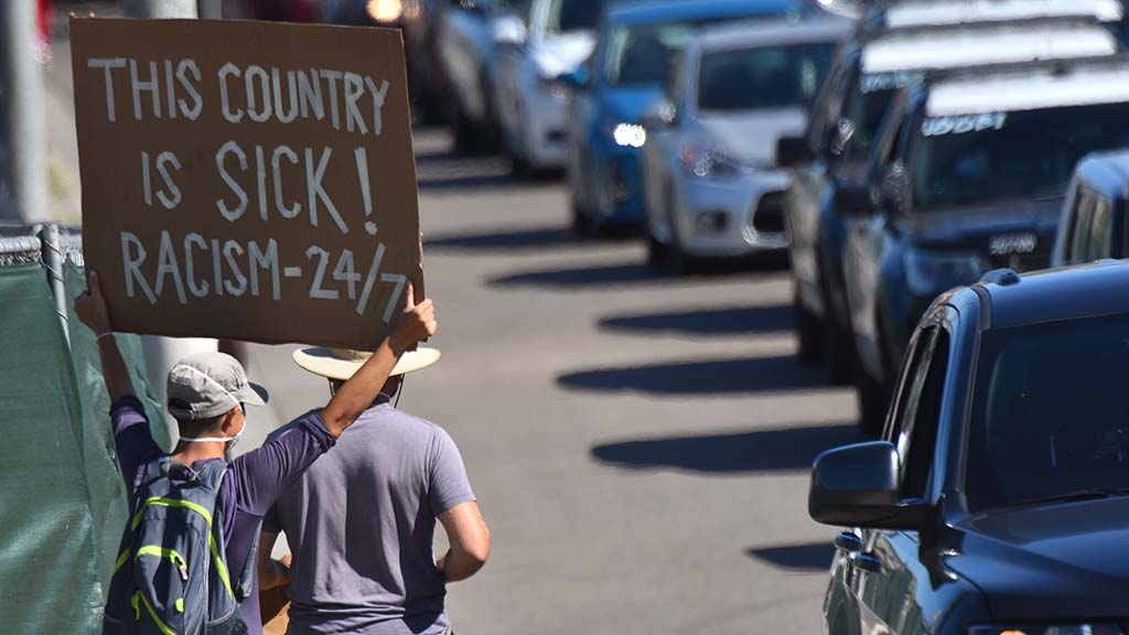 Sign-holders sought attention on Interstate 8 in La Mesa.