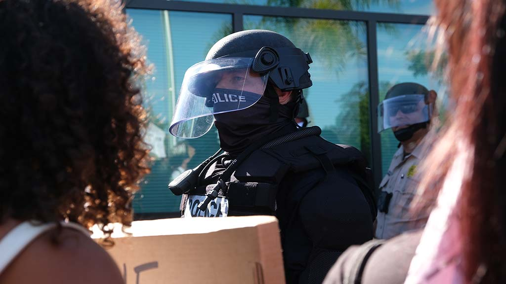 La Mesa police and county sheriff's deputies wore face shields near the entrance to the La Mesa police station. Photo by Chris Stone