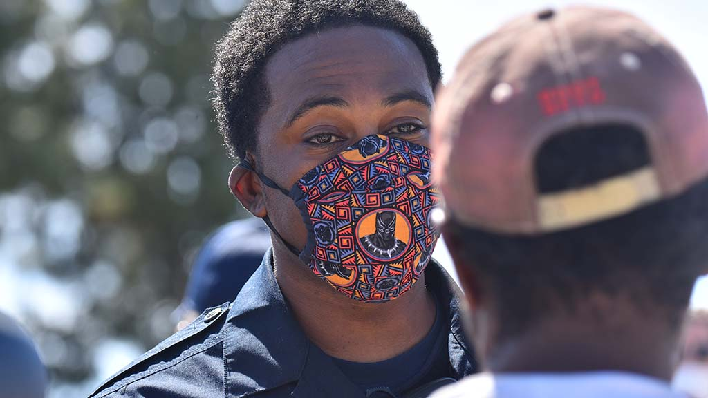 A protester's face mask bore the image of the Black Panther movie and Marvel cartoon superhero.