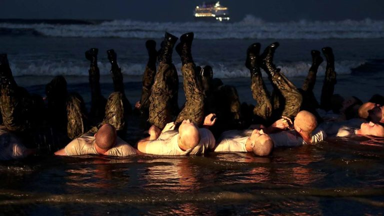 SEAL candidates perform physical training on the beach during Basic Underwater Demolition/SEAL (BUD/S) training at Naval Special Warfare Center in Coronado. Photo by Mass Communication Specialist 1st Class Anthony Walker