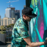 Artist Christopher Konecki paints the mural for Bay City Brewing
