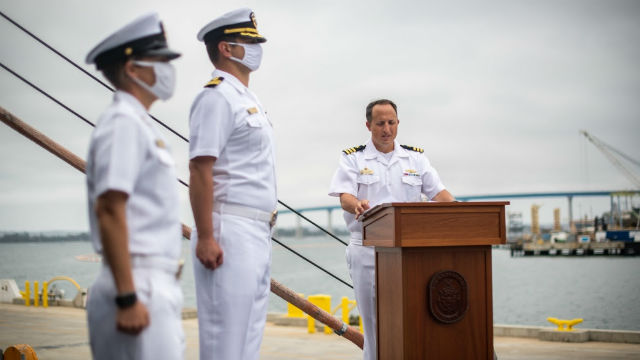 Cmdr. R.J. Zamberlan of the USS Kansas City reads his orders