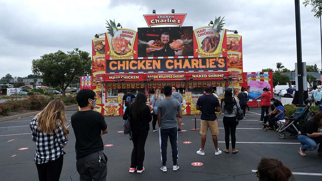 Customers waited after they ordered food on opening day of Chicken Charlie's in Grossmont Center in La Mesa