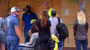 A boarded-up business in La Mesa's downtown Village was backdrop for La Mesa Civil Defense's first in-person meeting.