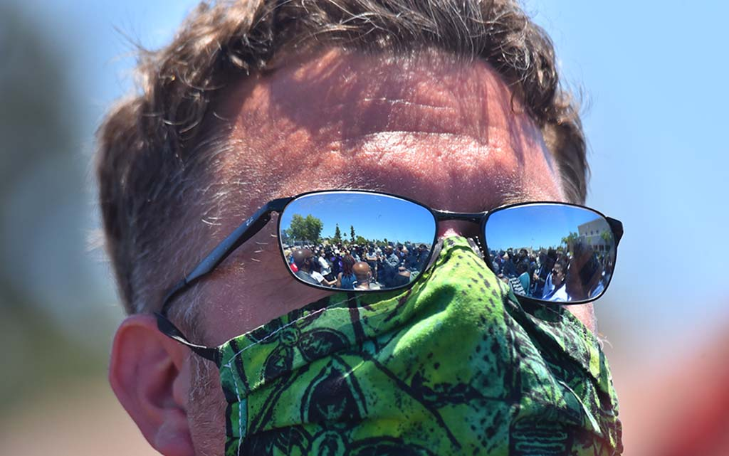 A protest with about 400 participants is seen in a demonstrator's glasses.