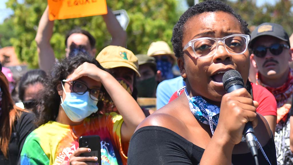 Christina Griffin-Jones speaks to protesters at a protest making demands of the La Mesa Police Department follow the shooting of a protestor on May 30.