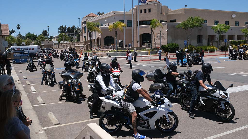 Numerous motorcycle clubs drove into the La Mesa Police Department parking lot to start the protest.