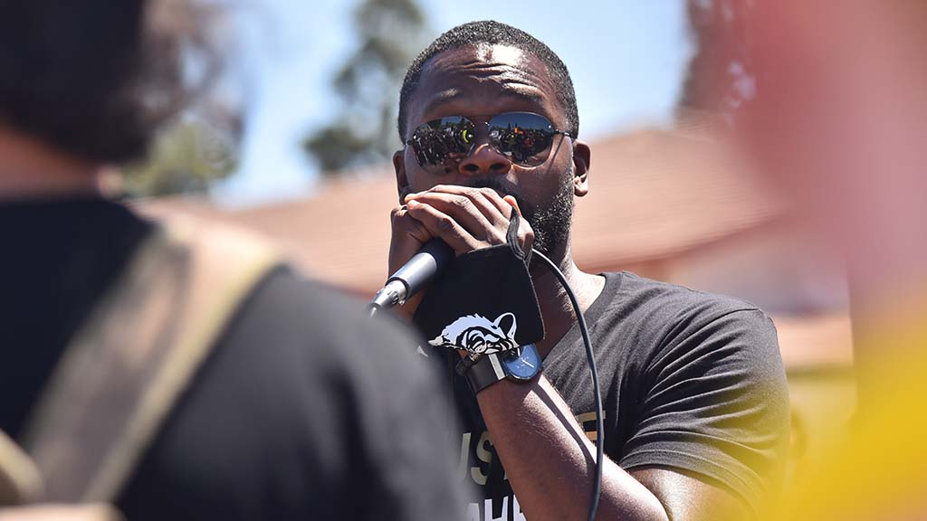 Attorney Dante Pride, who represented Leslie Furcron after she was shot in the forehead at the previous La Mesa protest, spoke to the crowd on June 14.