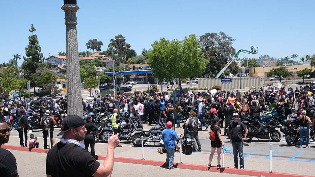 About 400 protesters, including members of motorcycle groups, brought demands to the La Mesa Police Department.