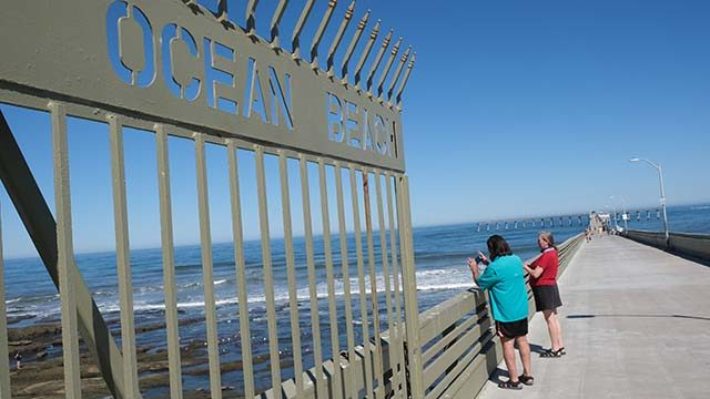 Walkers and fishermen at Ocean Beach Pier took advantage of the opening day for city piers on June 9.